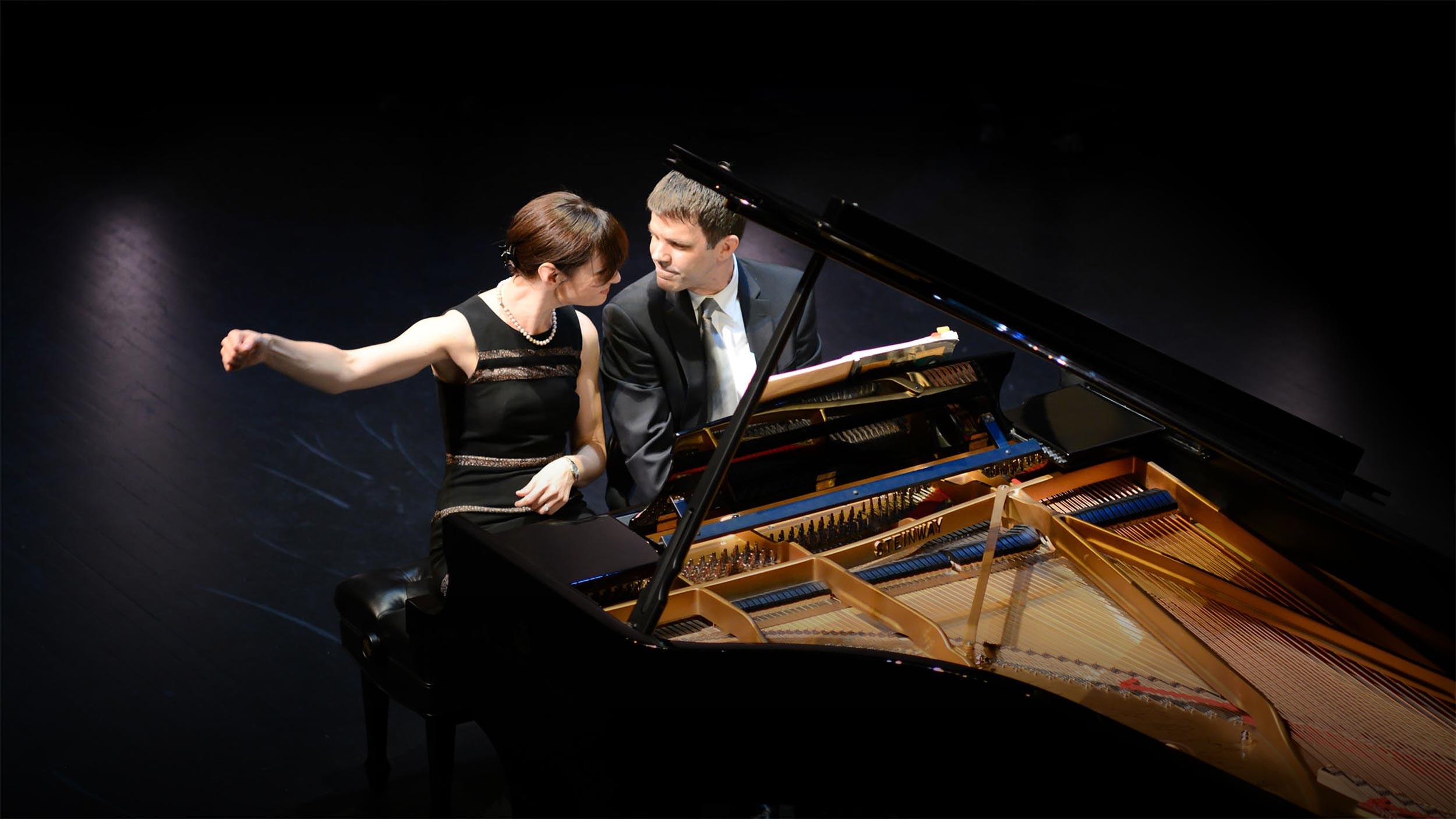 Lomazov Rackers piano duo playing piano