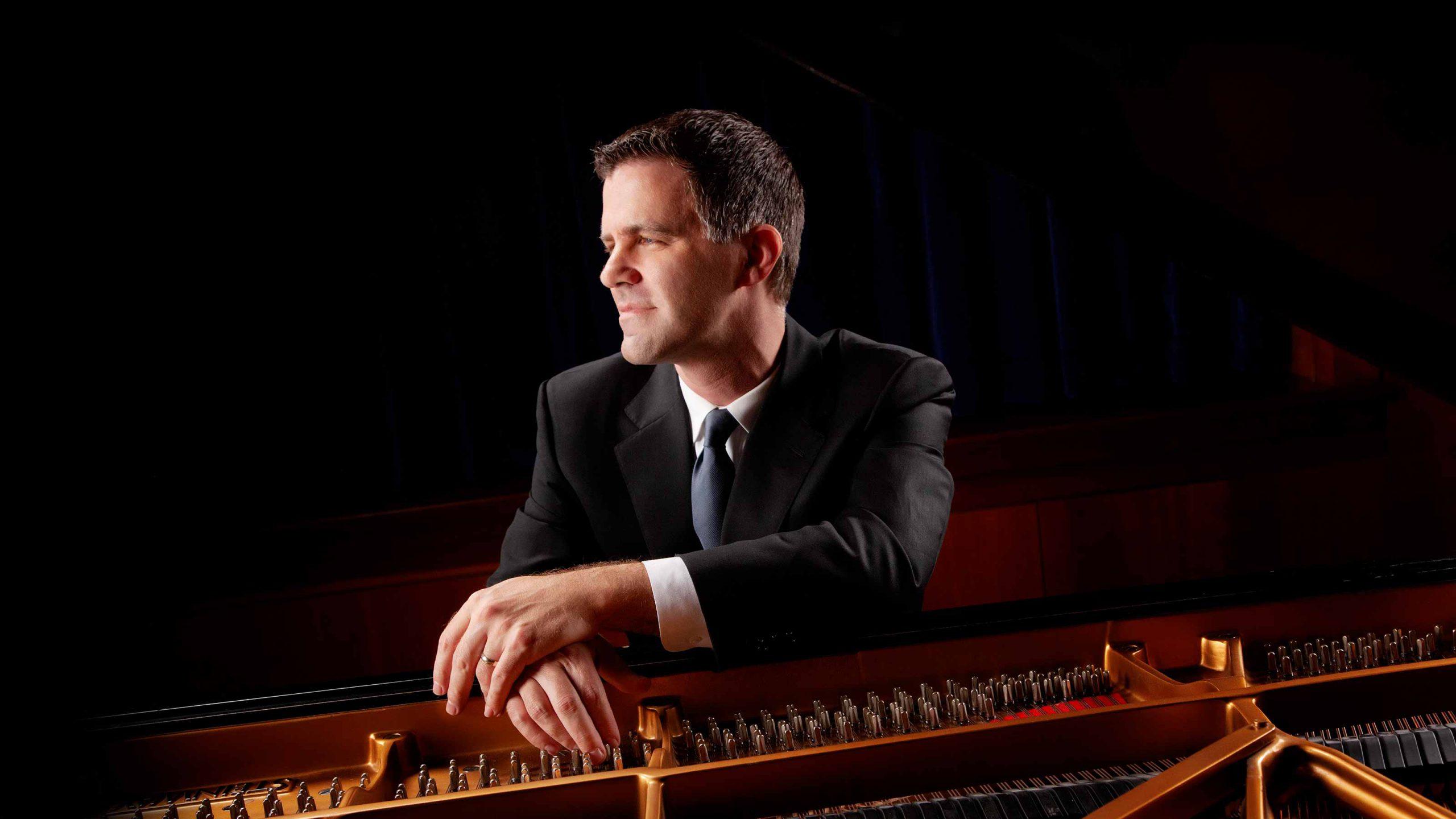 Joseph Rackers at an open piano