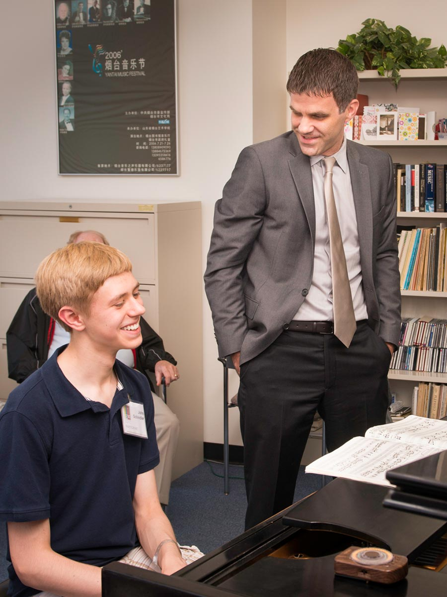 Joseph Rackers working with a student
